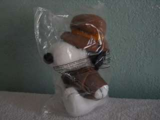 FROM PEANUTS INDIANA JONES DOG PLUSH DOLL. HE IS 7 INCHES LONG